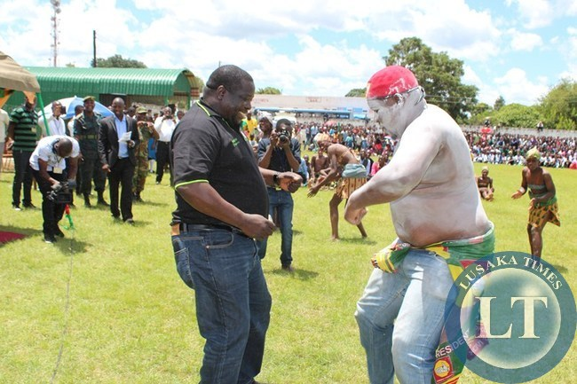INFORMATION and Broadcasting Minister Chishimba Kambwili and a youth from United Party for National Development (UPND) join St. Mark's Secondary School culture group (not in picture). This was during the Youth Day celebration at Choma stadium