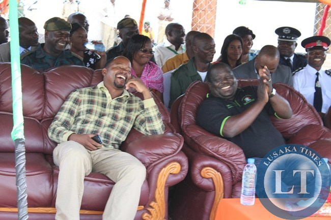 INFORMATION and Broadcasting Minister Chishimba Kambwili (r) and Choma Central Member of Parliament Conelius Mweetwa laugh and applause the dance by St. Mark's Secondary School culture group (not in picture). This was during the Youth Day celebration at Choma stadium