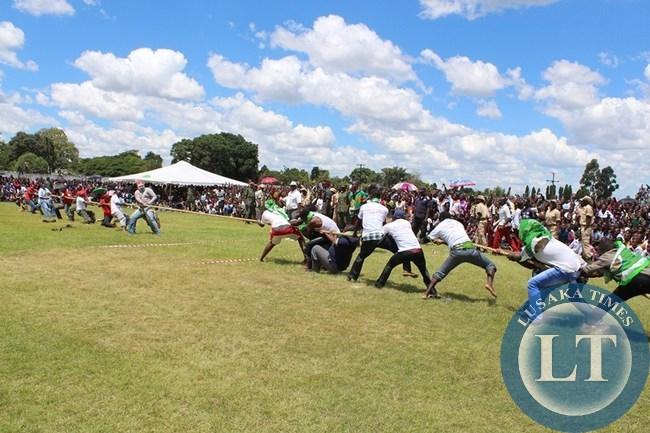 FEMALE youths from United Party for National Development (UPND) (left) and Patriotic Front (PF) battle in Tag of War game as a sign of promoting unity. This was during the Youth Day celebration at Choma stadium