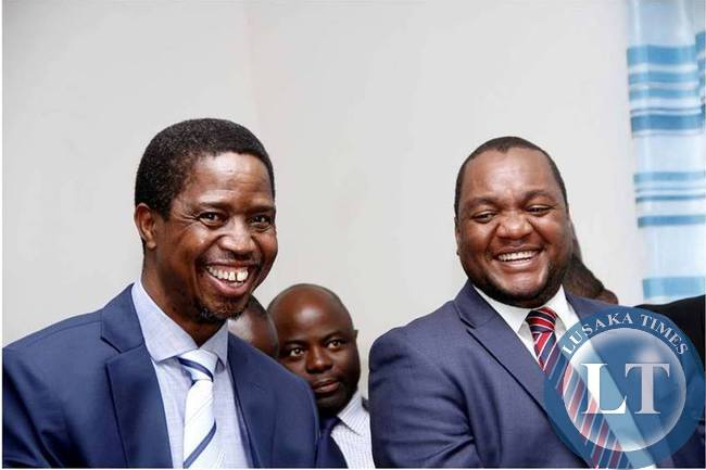 President Edgar Lungu share alight moment with Commerce deputy minister Miles Sampa (r) at Chawama Basic school on March 10,2015, where he witnessed the filling in of nomination papers of Chawama Constituency PF Parliamentary Candidate Lawrence Sichalwe
