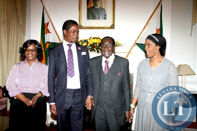 President Lungu, First Lady Esther Lungu with Zimbabwe's President Robert Mugabe and Zimbabwe's First Lady Grace  shortly before a closed door meeting  at State House in Harare on April 28,2015 -Picture by THOMAS NSAMA