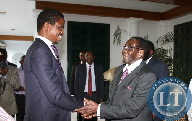 President Edgar Lungu being welcomed by Zimbabwe's President Robert  Mugabe  at State House on April 28,2015. Looking on are Zambia's First Lady Esther Lungu and Zimbabwe's First Lady Grace Mugabe  -Picture by THOMAS NSAMA