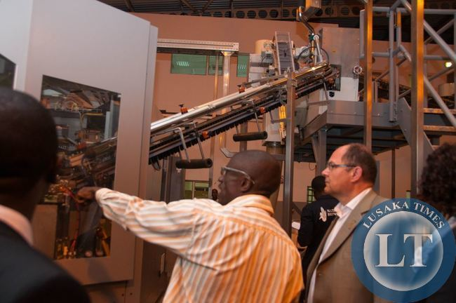 Pic 1 - Zambian Breweries Group Technical Manager Stan Kasoka explains a...