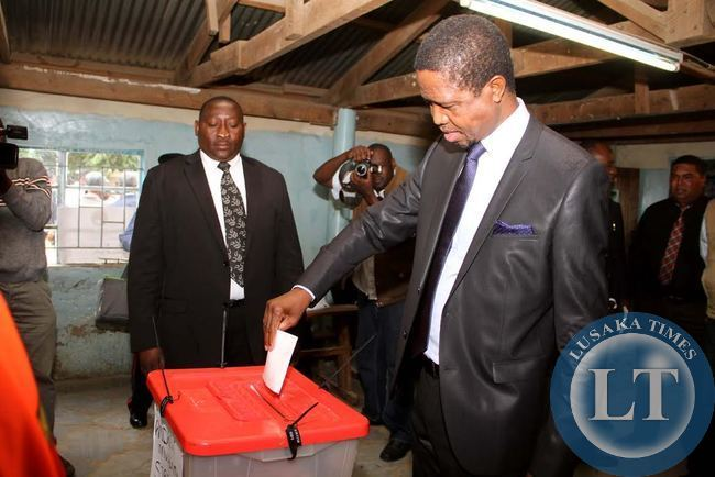 President Edgar Chagwa Lungu casts his voting at Andrew Mwenya Polling Station in Lusaka's John Howard Township on April 15,2015. PF's Lawrence Sichalwe and UPND's Charles Kaselwa are Hoping to succeed President Lungu in an array that has also attracted National Revolution Party president Cozmo Mumba's wife , Martha, UNIP's Bywell Kaluba and 4th Revolution Party's Benson Silwimba -Picture by THOMAS NSAMA