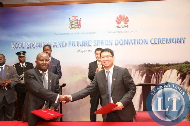 President Edgar Lungu and Huawei Senior Vice-President Dafeng Li witnessing the signing ceremony between Huawei Zambia managing director Fan Wen and Ministry of Energy representative Victor Mudende at Shenzhen Wuzhou Guest House on April 1,2015 -Picture by THOMAS NSAMA
