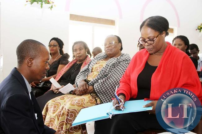First Lady Esther Lungu signs a book of Condolences upon arrival at St Pauls UCZ Church for the funeral service of Late Rev Sampa Bredt in Lusaka on April 10,2015 -Picture by THOMAS NSAMA