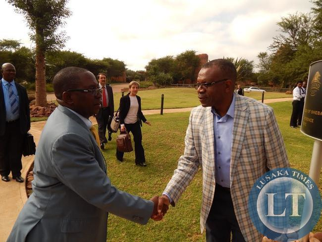 ZAMBIA'S High Commissioner to South Africa, His Excellency Mr. Muyeba Chikonde (r) welcomes Foreign Affairs Deputy Minister, Mr. Rayford Mbulu when he arrived at the venue for the 14th Africa - Nordic Meeting at Legends Golf Safari Resort in Limpopo, South Africa, on Friday, 10th April, 2015.