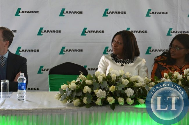 Commerce Minister Margaret Mwanakatwe flanked by Lands Minister Christabel Njimbu listens attentively during the laying of the foundation stone ceremony