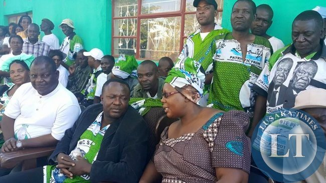 Dora Siliya surrounded by MMD Councillors who have also defected to the PF