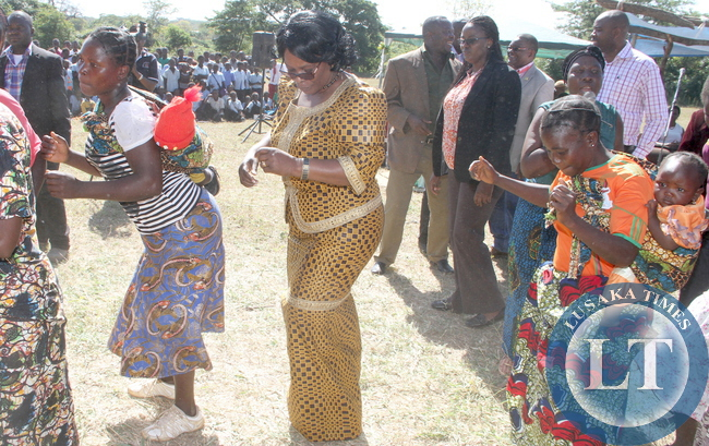 First Lady Esther Lungu join women in dancing  in Hofmeyer in Nyimba District, Eastern Province where she addressed them and donated shoes to school pupils on May 20,2015 -Picture by THOMAS NSAMA