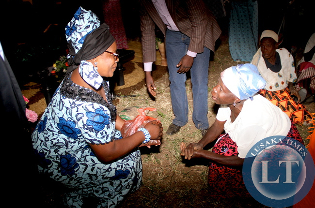 An elderly woman thanksFirst lady Esther Lungu after she donated foodstuffs and cloths to them at Chiwuyu primary school in Sinda District on May 20,2015 -Picture by THOMAS NSAMA