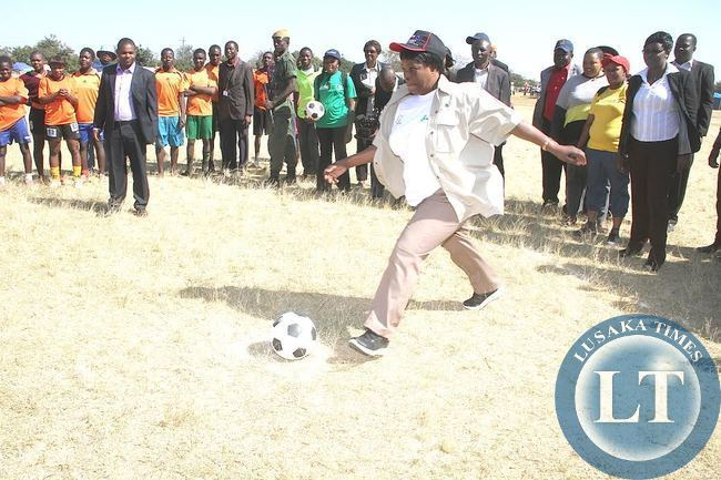 First Lad Esther Lungu kicks the ball during Commemoration of the International VCT day in Lusaka on June 30,2015 -Picture by THOMAS NSAMA
