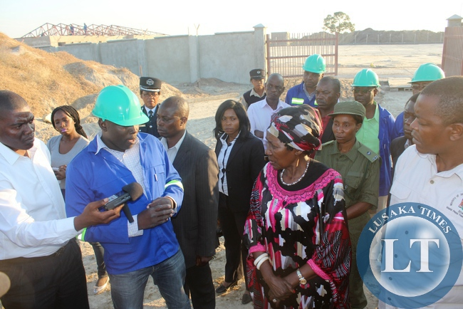 Vice President Inonge Wina (c) with Western Province Minister Poniso Njeulu (r) and Belgravia Services Limited Site Manager Collins Kipkorir (l) at the construction site of a modern fuel depot inspecting the work progress in Mongu
