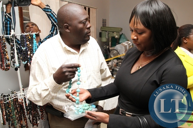 Davies Banda Gemstone Tress manufacturing shows finished product to Commerce Minister Margaret Mwanakatwe during the valuation additional programme for miners