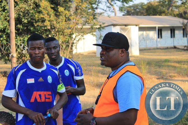 Assistant Coach George Chilufya  gives a halftime talk to the Radiants