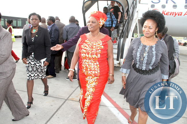 First Lady Esther Lungu with Zambia's High Commissioner to Kenya Brenda Muntemba (l)  and Kenya's Senator Emma Getrude  Mbura (r) on arrival at Jomo Kenyatta International Airport  for  the 9th Stop Cervical, Breast and Prostate Cancer in Africa Conference in Nairobi on July 18,2015 -Picture by THOMAS NSAMA