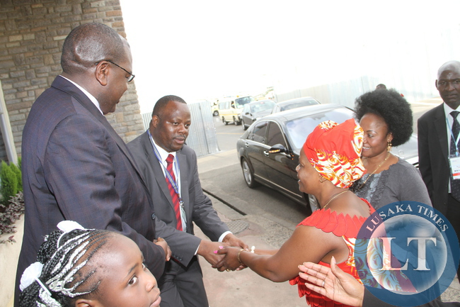 First Lady Esther Lungu being welcomed by Zambia's deputy  High Commissioner to Kenya Robert Kalimi Kaela as Health Deputy minister Dr Chitalu  Chilufya on arrival at Jomo Kenyatta International Airport  for  the 9th Stop Cervical, Breast and Prostate Cancer in Africa Conference in Nairobi on July 18,2015 -Picture by THOMAS NSAMA