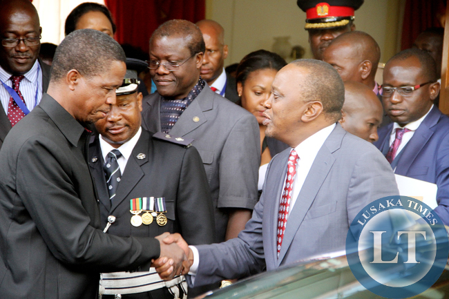 President Lungu and    Kenya's President Uhuru Kenyatta with Ministers after the bilateral talks at State House in Lusaka on July 3,2015 -Picture by THOMAS NSAMA