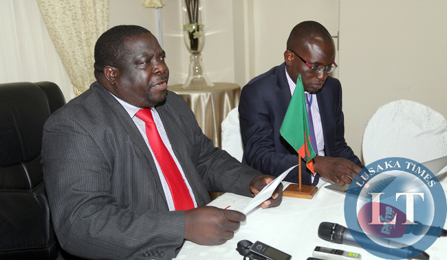 Mr Chishima Kabwili  with Amos Chanda at Statehouse Press Briefing at Statehouse