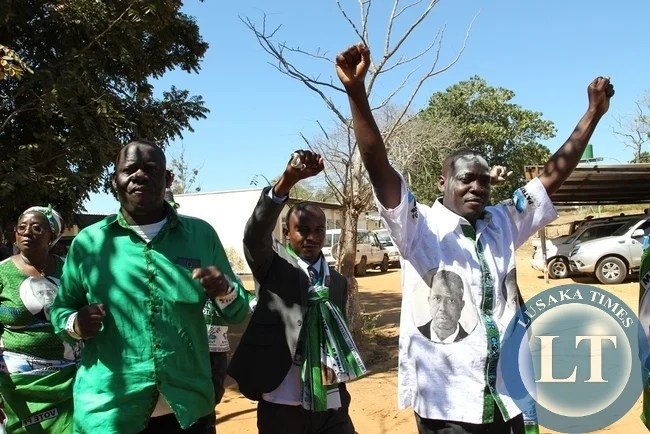 PF candidate Anthony Kasandwe celebrates after successfully filing nominations as aspiring candidate for Bangweulu constituency, in Samfya. Celebrating with him is Home affairs Minister Davis Mwila and Community Development minister EmerineKabanshi.