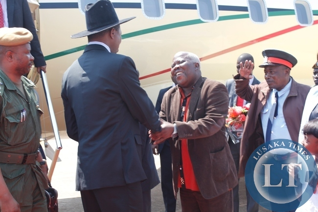 President Edgar Lungu being received by Northern Province Minister, Freedom Sikazwe when he made a stop over at Mbala's Samora Machel Airbase on his way to Mwansabombwe from Uganda