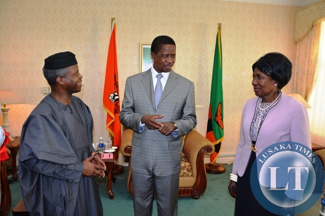 President Edgar Lungu flanked by his Vice President Inonge Wina chats Nigerian Vice President Yemi Osinbajo shortly after Courtesy call at State House