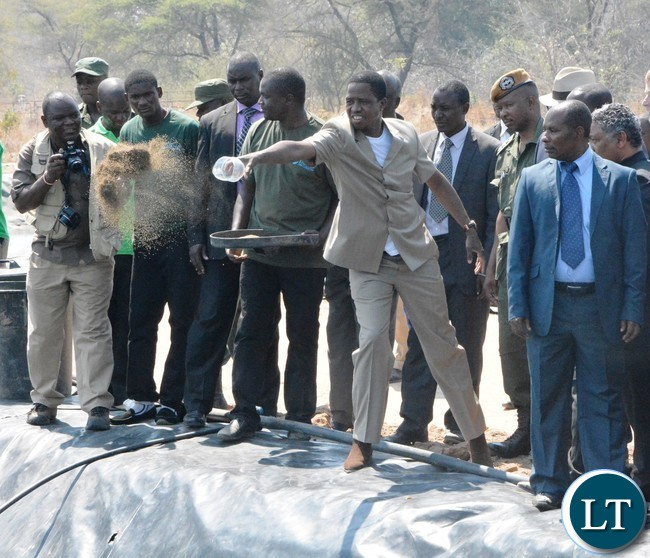 President Edgar Lungu feeding fish Shortly after Commissioning of Yalelo Zambian Fish in Siavonga