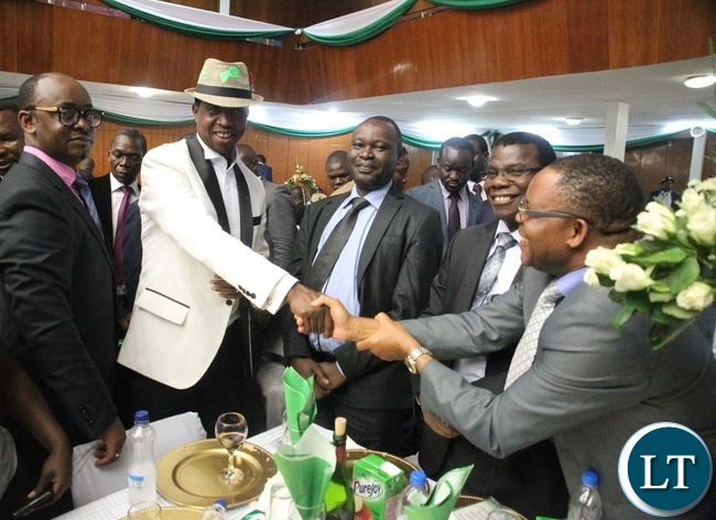 President Edgar Lungu shakes hands with the audience during the meet the President Fundriasing dinner at Mulungushi Conference center