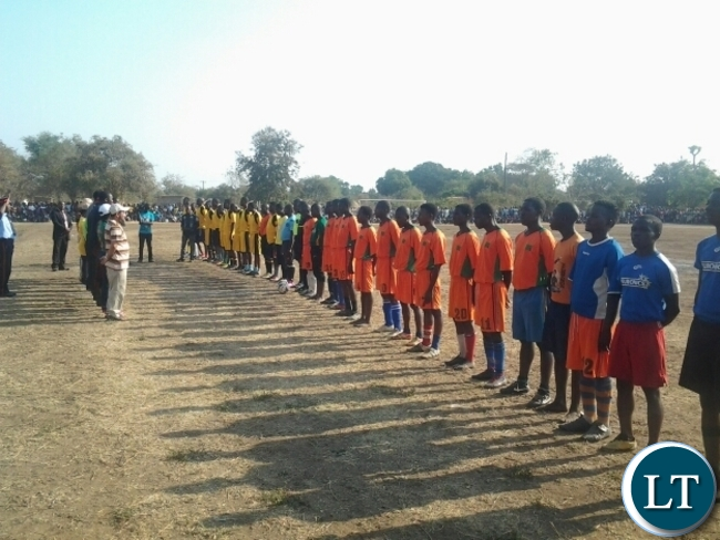 Government officials,sponsors of Kavulamungu sports tournament singing a national anthem during a final between Dushambe FC and Mambwe Warriors