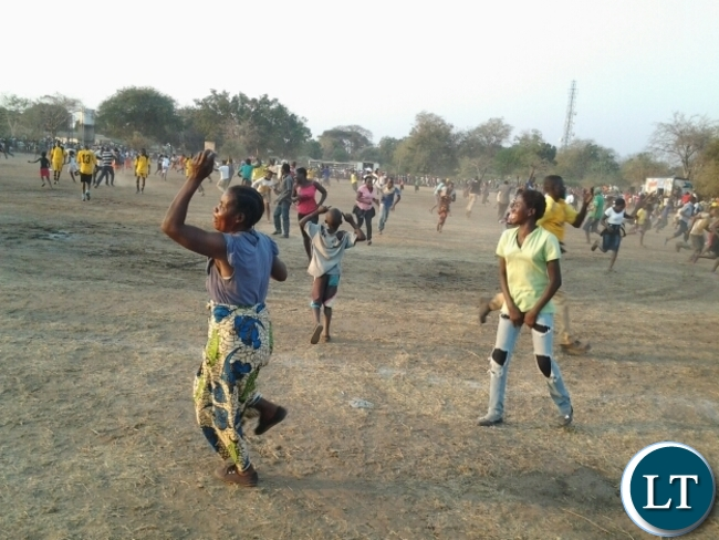 Soccer fans invading the Slam ground after Dushambe FC scored against Mambwe Warriors FC in Mfuwe at Kavulamungu sponsored tournament