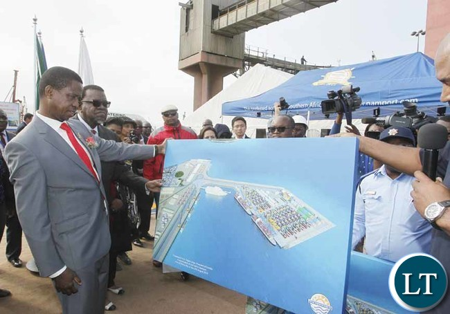 President Edgar Chagwa Lungu (left) and his Namibian counterpart Dr. Hage Geingob looks at the plan for the Namport port of Walvis Bay plan during the tour in Namibia on Thursday, August 27,2015. PICTURE BY SALIM HENRY/STATE HOUSE ©2015