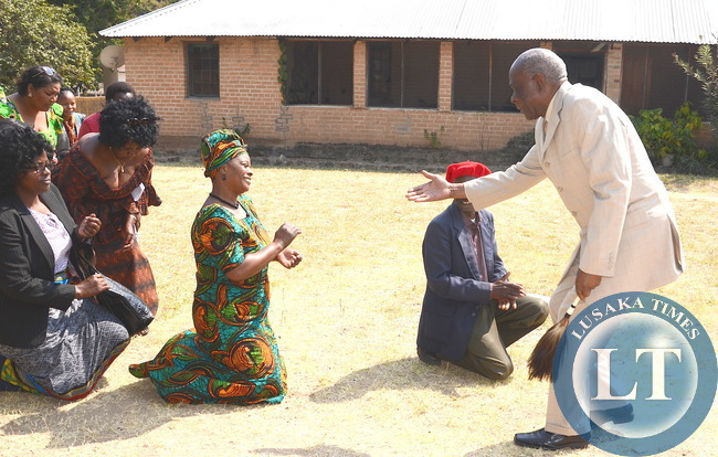 First Lady Esther Lungu greets Senior Chief Amukena II on arrival at his palace in Kaoma where she paid a Courtesy call on him in Western Province on Saturday, August 15,2015 -Picture by THOMAS NSAMA