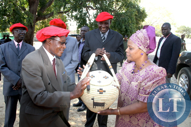 First Lady Esther Lungu receives a gift from Induna's on arrival  at Limulunga where she paid a courtesy call on the Litunga on August 12,2015. The First Lady is in Western Province on the outreach Programme for People with Special needs -Picture by THOMAS NSAMA/STATEHOUSE