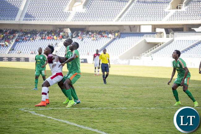 Nkana striker Walter Bwalya shields Zesco United midfielder Justin Zulu and Misheck Chaila in a FAZ Super Division match. Zesco won the game 5-3.