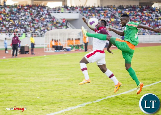 Nkana striker Jimmy Ndhlovu (l) battles for the ball with Zesco United defender Ayo Oluwafemi (r).