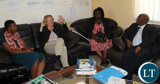 United Nations Resident Coordinator Janet Rogan talks to Tasila Lungu who is in their entourage visiting UNICEF and government sponsored Youth programmes in Northen Province. Listening also is Ministry of Youth and Sport Agnes Musunga and Northen Province Permanent Secretary Hlobotha Nkunika