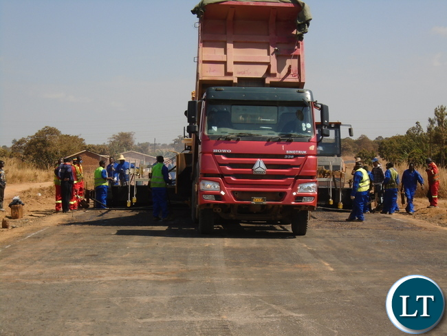 China CAMC Construction workers working on the Lot 2 of the  171 Km 180 million United Sates Dollars Nakonde / Mbala Road project in Muchinga Province