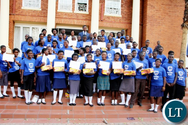 President Lungu and First Lady Esther Lungu and ministers spouses pose for a photograph with Junior achievers during the First Lady's Mentorship Programme of the Junior achievers at State House on August 10,2015 -Picture by THOMAS NSAMA / STATE HOUSE
