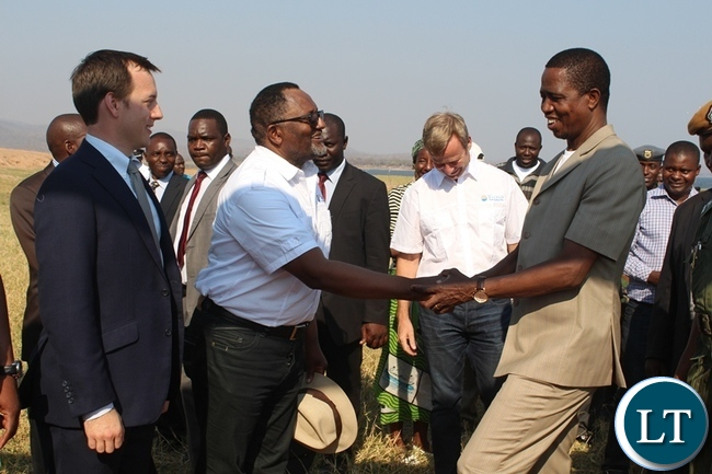 PRESIDENT Edgar Lungu (r) shakes hands with Yalelo Fresh Zambian Fish Company Director Fisho Mwale while Board Chairman Adam Taylor (l) looks on. This was after the official opening of a fish farming company at Kamimbi village in Siavonga district