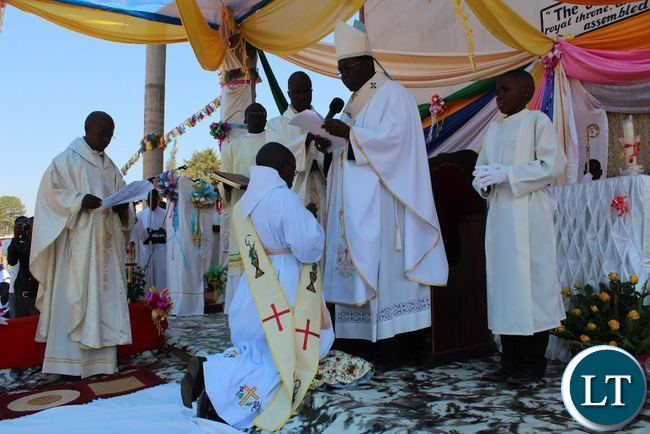 APOSTOLIC administrator of Mpika Diocese His Grace Archbishop Ignatius Chama blessing Brother Deogratius Sikazwe before ordaining him as a Catholic Priest. This was during an ordination ceremony held at Katibunga Parish in Mpika