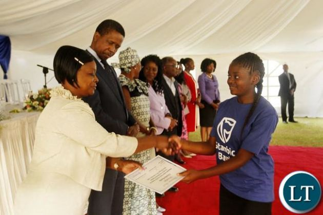 First Lady Esther Lungu (left) and President Edgar Chagwa Lungu (second from left) presents a certificate to Kunda Chomba (right) from Mupepetwe Secondary School in Central Province after she participated in the First Lady Mentorship Program at State House on Monday, August 10,2015. PICTURE BY SALIM HENRY/STATE HOUSE © 2015