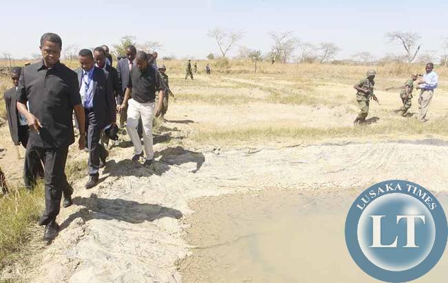 President Edgar Chagwa Lungu (left) inspects Fish Ponds at Palabana Fisheries in Chongwe District on Wednesday, August 5,2015. PICTURE BY SALIM HENRY/STATE HOUSE © 2015