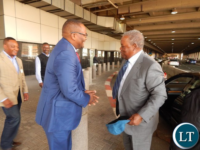Zambia's High Commissioner Designate to South Africa, His Excellency Mr. Emmanuel Mwamba meets former Zambian President Mr. Rupiah Banda when the latter arrived at Oliver Tambo International Airport