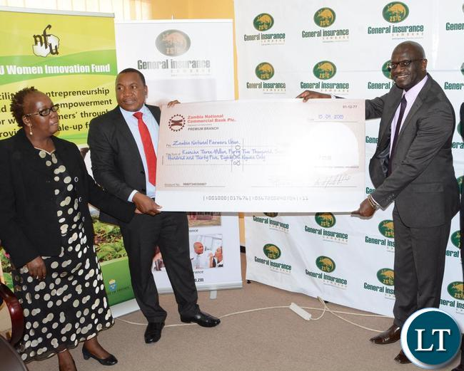 General Insurance Limited Managing Director Charles Nakhoze handover the cheque of K3, 042, 735 to Zambia National Farmers Union Executive Director Ndambo Ndambo who is flanked by his Deputy Executive Director Ellah Chembe during the handover of LIMA Credit Scheme Insurance pay-out
