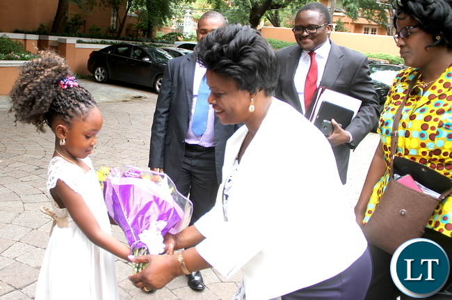 First Lady Esther Lungu receives a banquet of flowers from 6 year-old Greta Kalinda on arrival in Dallas-Texas for the Global Women's network summit organized by the George W. Bush Institute on Sunday, September 20,2015 -Picture by THOMAS NSAMA