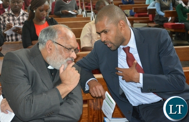 Minister of youth and sport Vincent Mwale chats with Rev Charlie Thomas during the scripture union of Zambia thanks giving service at the cathedral of holy cross in Lusaka