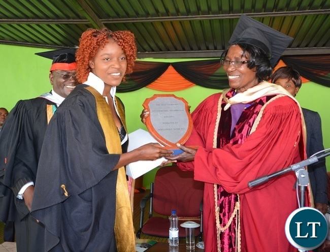 -Acting President Inonge Wina Presenting the Best student award in Accounting Technician to Diploma Rosemary Chimbwe during the NIPA 16th Graduation Ceremony