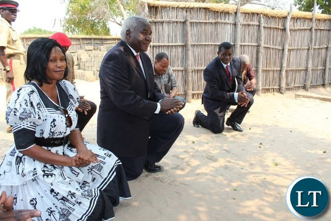 Deputy Minister of Home Affairs Col. Panji Kaunda (c) with his entourage show respect after paying courtesy call to Her Royal Highness Litunga La Mboela of Lwambi Chiefdom for the launch of Phase II of the 2015-2016 Mobile National Registration Card Exercise in Nalolo District, Western Province