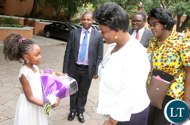 First Lady Esther Lungu talks to 6 year-old Greta Kalinda on arrival in Dallas-Texas for the Global Women's network summit organized by the George W. Bush Institute on Sunday, September 20,2015 -Picture by THOMAS NSAMA