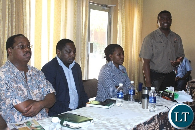 Ministry of Labour Principal Planner David Banda (r) addressing participants during the Validation workshop on Content and implementation of the Revised National Employment and Labour Market Policy for 2016-2020 in Mongu
